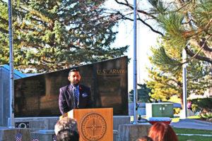Student veteran Richard Brown sings star-spangled banner at Veterans Day Memorial ~ photo by Pengjiu Liu