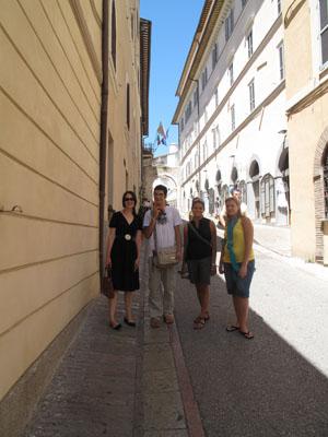 Adrianne Hamilton, Javen Mondragon, Kayla Monack and Melissa Garduno on a street in Italy. photo by Chris Picicci