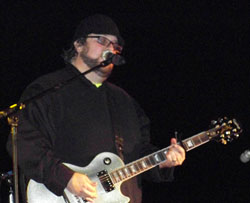 Mark Bush, lead singer and guitar player in Mark's Midnight  Carnival Show. photo by DaMarkus James