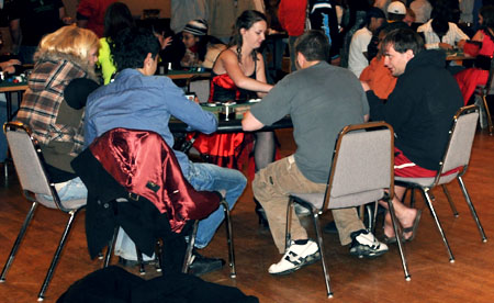 Alicia Beauer (red dress) deals another round at the Wild West Casin Night. photo by Zak Bratton