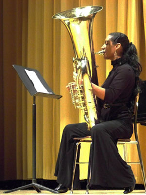 "Erika Devins plays the tuba at ""Octubafest."" photo by DaMarkus James"