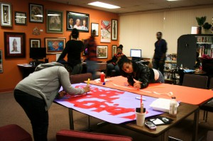 Students prepare posters for Black Student Organization's Gospel Explosion in 2011. | File photo