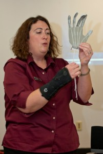 """Amy Robinson shows education students how to make a """"robotic"""" arm for young students."""