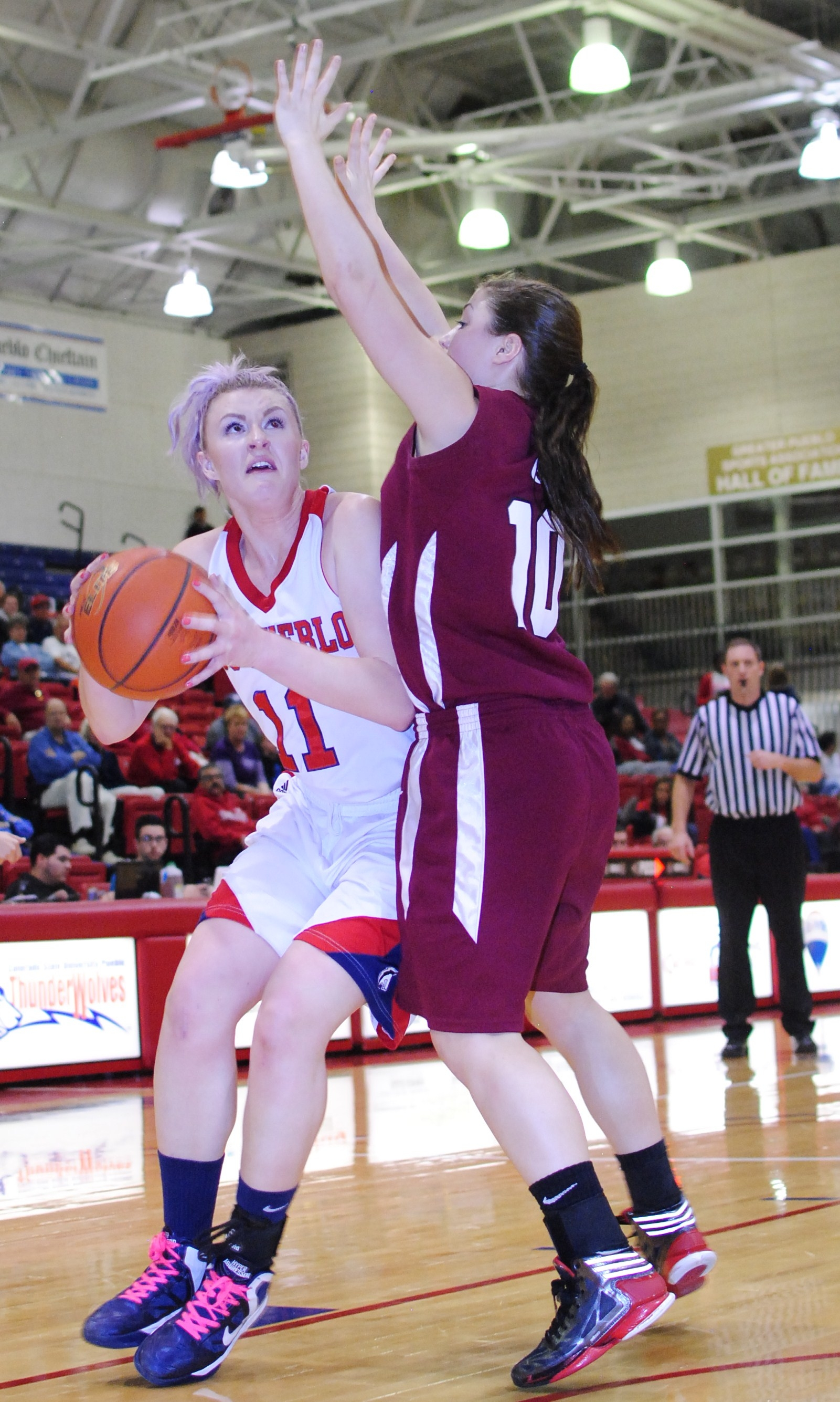 Senior Caiti Forrester drives in for a basket on Saturday's game against CSC. Photo courtesy of Tyler Shomaker