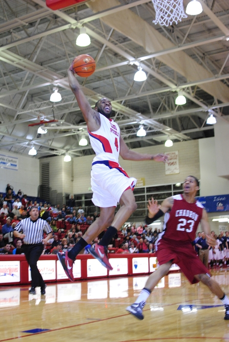 Wendell Lee floats in the air as he lays in a basket for the Thunderwolves. Photo courtesy of Tyler Shomaker