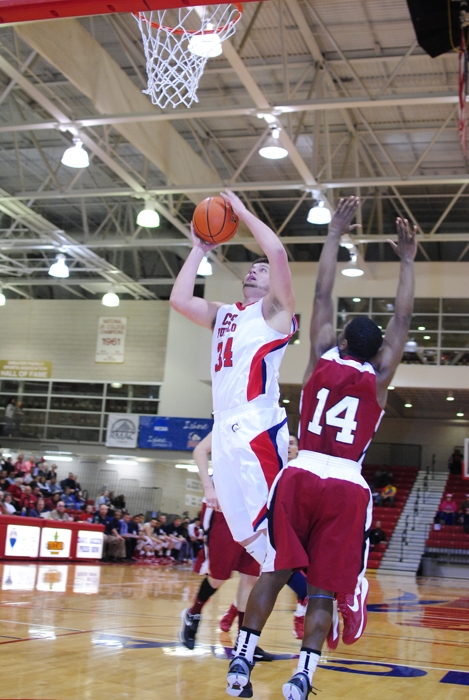 Matt Rosenbaum fights for a basket in Saturday's game against CSC. Photo courtesy of Tyler Shomaker