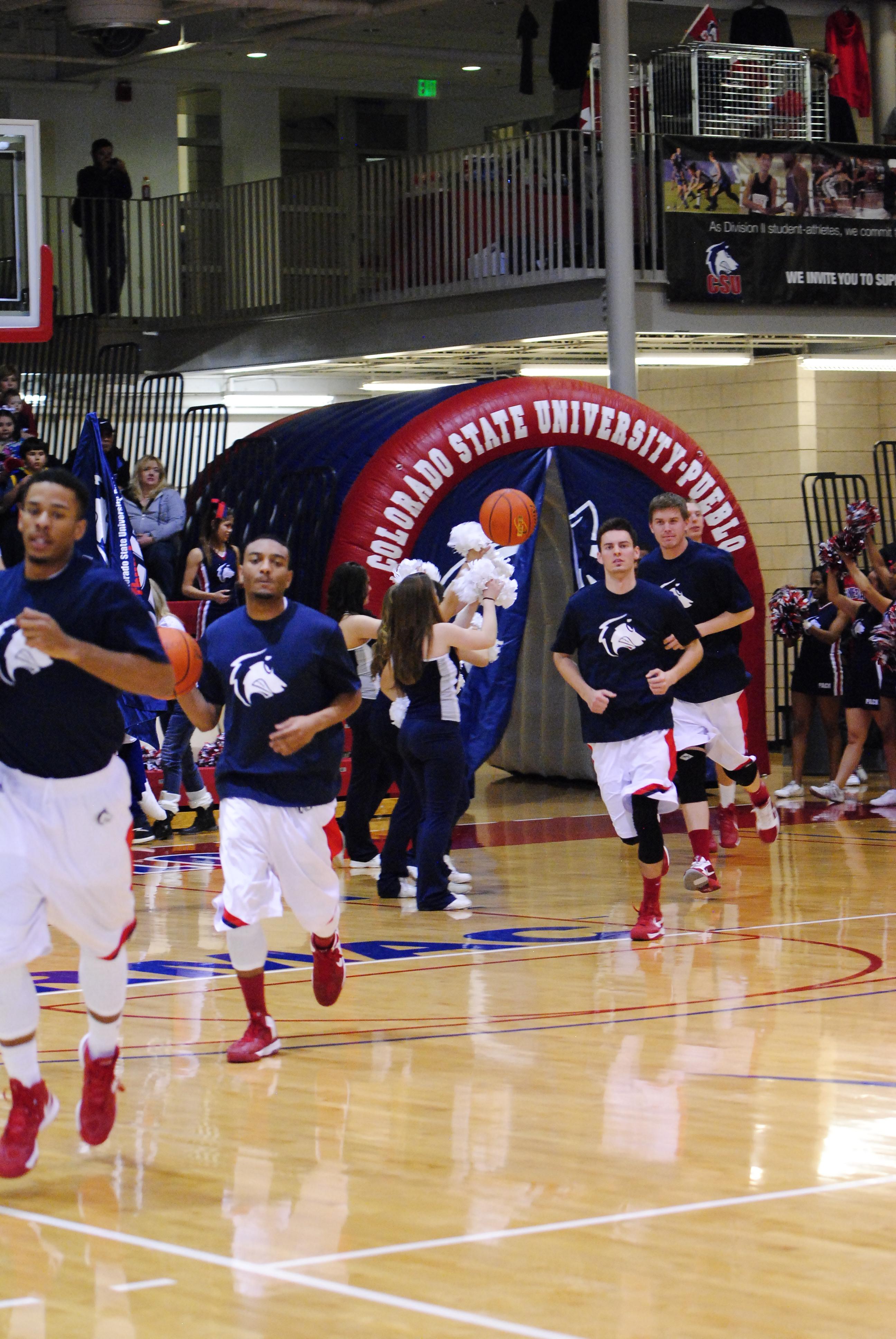 CSU-Pueblo men's basketball team runs out on to the court. Photo courtesy of Tyler Shomaker