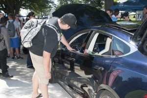 CSU-Pueblo students checking out the Tesla Model S at the Involvement Fair. Photo courtesy of Tyler Shomaker
