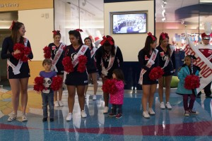 Cheerleaders interact with children at the Colorado Children's Hospital.
