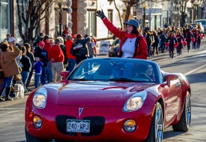 President Lesley Di Mare waves to fans at the Parade of Champions. Photo by Dustin Cox