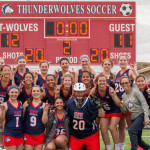 CSU-Pueblo Women's Lacrosse team poses for photos in front of the score board after their win 12-11 win. Photo Credit: Dustin Cox