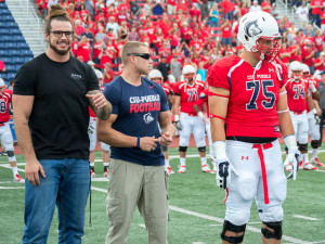 Josh Bredl (left) returned to CSU-Pueblo for the football team's season opener. | Photo by Dustin Cox
