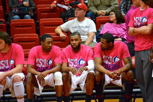 Wendell Lee (middle), and teammates on the bench before a game against Fort Lewis on February 14, 2014. Photo by Dustin Cox.
