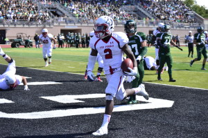 Bernard McDondle runs in for a touchdown against Adams State. Photo by Dustin Cox.