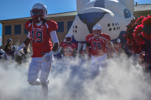 Pack players exit the ThunderWolf tunnel before entering a playoff game against the University of Indianapolis. | Photo by Jason Prescott