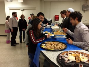 Students are served traditional Diwali food. Photo by Keelan Bailey.
