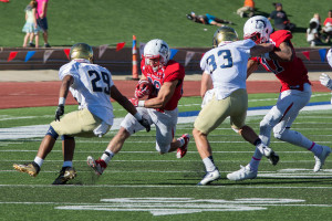Austin Micci looks for room to run against Fort Lewis ~ photo courtesy of Jason Prescott