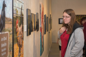 Student attendee appreciating art at the annual CSU-Pueblo Student Art Show