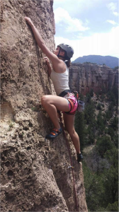 Kiersten Senff climbing at Shelf Road on a past Outdoor Pursuits trip.  ~ photo courtesy of Jenn de Groot